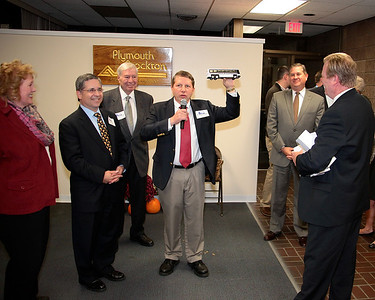 P&B General Manager Mark Richardson holds up a model P&B Bus given to each of the Plymouth Board of Selectman.