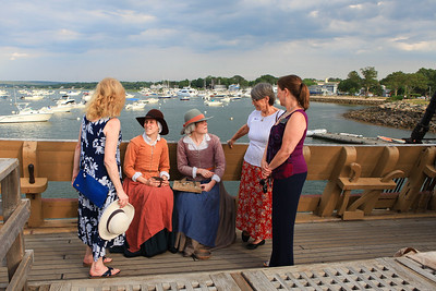 "Janet Humes of Stroup Associates, Suzanne Babcock of Hampton Inns, right and Paula Fisher of Destination Plymouth County, ""network"" with Pilgrims staunchly in character Desire Minter and Alice Rigsdale.Wicked Local Photo/Denise Maccaferri"