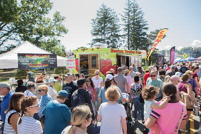 Food trucks and vendors were lined up from the Pilgrim Memorial State Park all the way to and past the Town Brook offering wide variety of foods to the throngs of harbor festival goers.  [Wicked Local Photo/Denise Maccaferri]