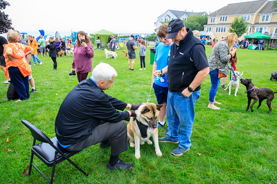James Green and his son Saiden from Quincy look on as ther dog Duke receives a blessing from New Testament Church of Cedarville Paster Dr.Paul Jehle.