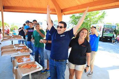 Cara Cipollo, Marketing Director of P & JV Mgt. Corp. congratulates a happy Joe Garcia of Pembroke the winner of the Mamma Mia's Pizza Eating Contest.