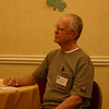 Peter listens to Cliff's presentation.