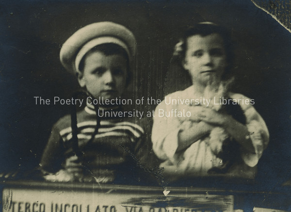 Lucia and Giorgio Joyce with kitten standing at window of their flat in Trieste