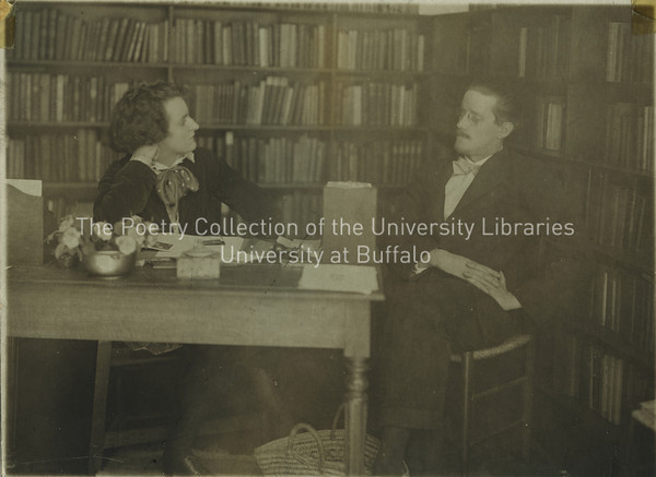 James Joyce and Sylvia Beach seated at table in Shakespeare and Company