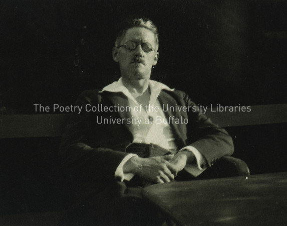 James Joyce seated on bench at Fechamp--full front view