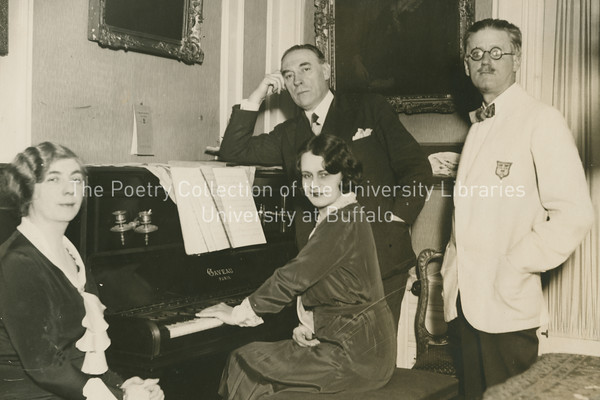 James Joyce with Nora, John Sullivan and Mrs. Sullivan, grouped at piano