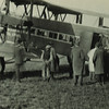 Group at door of airplane, Ostend