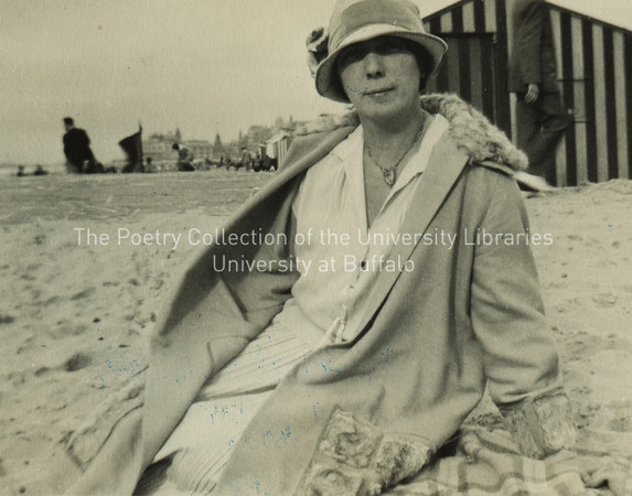 Nora Joyce seated on bench before cabana, Ostend