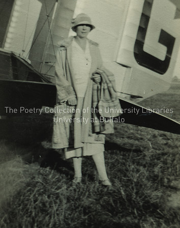 Nora Joyce standing near airplane, Ostend