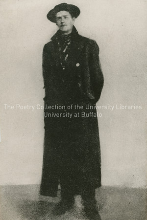"""Photographs from the La Hune exhibition--Joyce standing in great coat with """"Joyce during the first Paris years"""" printed on front"""