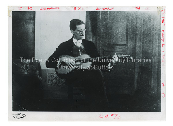 James Joyce seated, playing guitar, Zurich