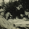 James Joyce, Nora, and Giorgio seated at table, possibly at Ostend