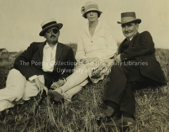 James Joyce, Nora Joyce, and P.J. Hoey seated on grass