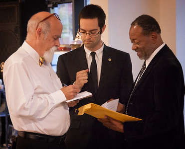Confab before the performance: Larry D. Dean, Marshall Gross, Lenard D. Moore.