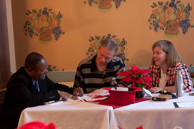 Lenard D. Moore, Curtis Dunlap, and Ce Rosenow review one of the poems submitted to the anonymous haiku workshop.