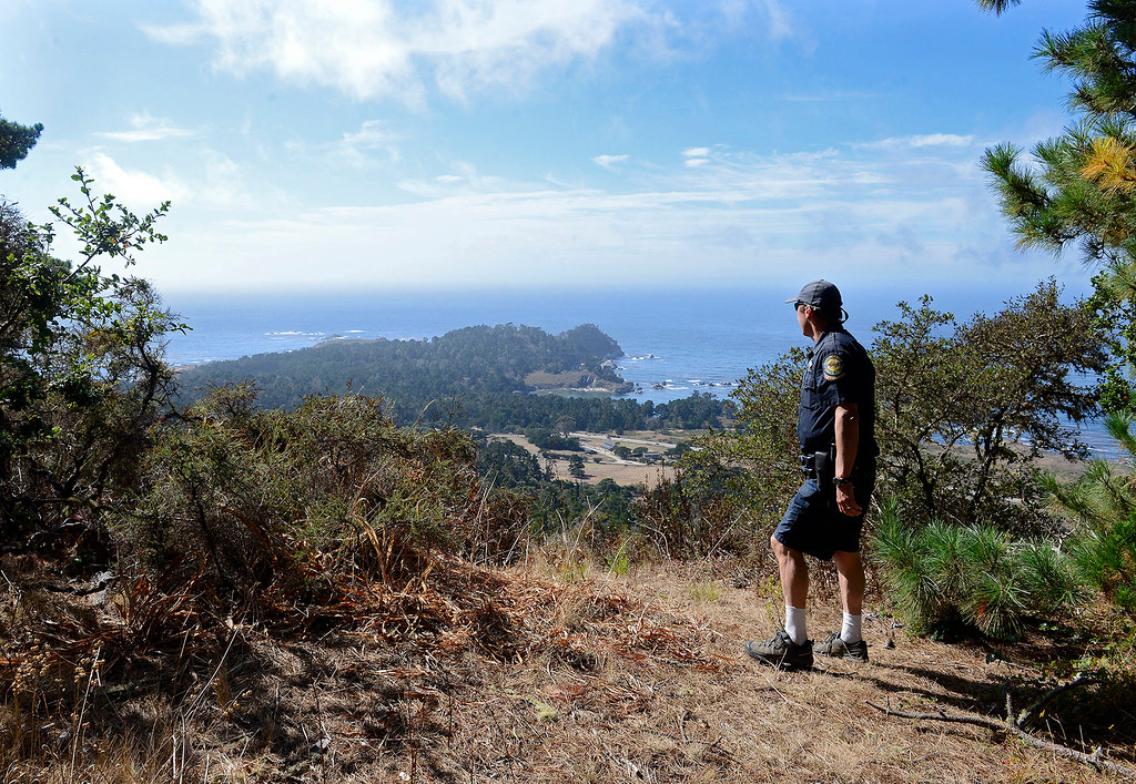 . California State Park officer Kevin Brady looking over Point Lobos State Reserve from the Point Lobos Ranch property on Wednesday, September 12, 2018.  (Vern Fisher - Monterey Herald)