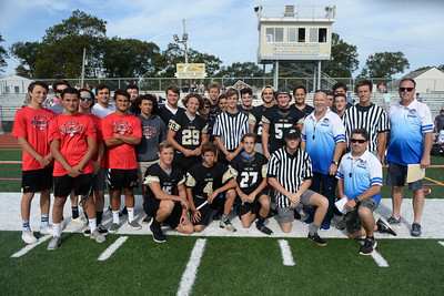 Point Pleasasnt Boro and Point Pleasant Beach High School Football Team members join the coaching staff of the Point Pirates Challenger Football Team prior to the opening kickoff of the 2019 season at Point Pleasant Boro High School Field, on 09/01/2019. (STEVE WEXLER/THE OCEAN STAR).