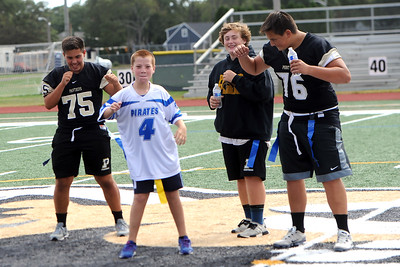 """#4, Parker """"The Conquer"""" Carroll of the Point Pirates Challenger Football Team shows off his dance moves with some help from some Point Pleasant High School Football Players during the halftime show at their Opening Day Game, at Point Pleasant Boro High School Field, in Point Pleasant Boro, NJ on 09/01/2019. (STEVE WEXLER/THE OCEAN STAR)."""
