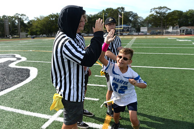 """#32, Nikita """"Dangerous"""" Digironimo of the Point Pirates Challenger Football Team takes the field at the 2019 Opening Game, in Point Pleasant Boro, NJ, on 09/01/2019. (STEVE WEXLER/THE OCEAN STAR)."""
