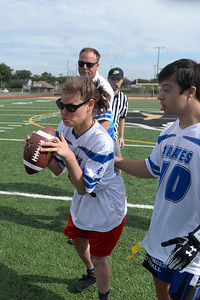 """#14, Beth """"Badass Detata of the Point Pirates Challenger Football Team gains some yardage in their 2019 Opening Game, in Point Pleasdant Boro, NJ, on 09/01/2019. (STEVE WEXLER/THE OCEAN STAR)."""