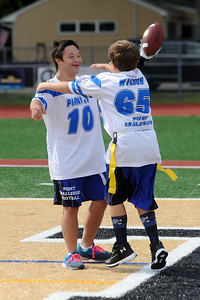 """#10, David """"The Beast Richards"""" celebrates a Point Pleasant Pirates Challenger Football Team touchdown with teammate Donald """"Wildman"""" Wilson during their season opener, at Point Pleasant Boro High School Field, in Point Pleasant Boro, NJ on 09/01/2019. (STEVE WEXLER/THE OCEAN STAR)."""