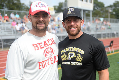 Point Pleasant Beach High School Varsity Football Head Coach Joseph Zaccone and Point Pleasant Boro High School Varsity Football Head Coach Brian Staub are seen on the sidelines of the Point Pirates Challenger Football Season Opener, a program in which both School Football Programs contribute to, in Point Pleasant Boro, NJ on 09/01/2019. (STEVE WEXLER/THE OCEAN STAR).