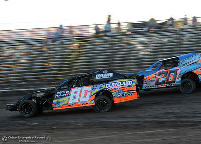Phillip Shelby (86) passes Jeremy Phillips (28P) in the Sport Modified class Friday, June 30, 2017, at the Silver Dollar Speedway in Points Race No. 8 in Chico, California. (Dan Reidel -- Enterprise-Record)