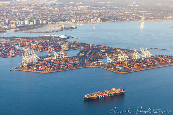Full cargo ship at Port of Long Beach with Downtown Long Beach and Queen Mary in background