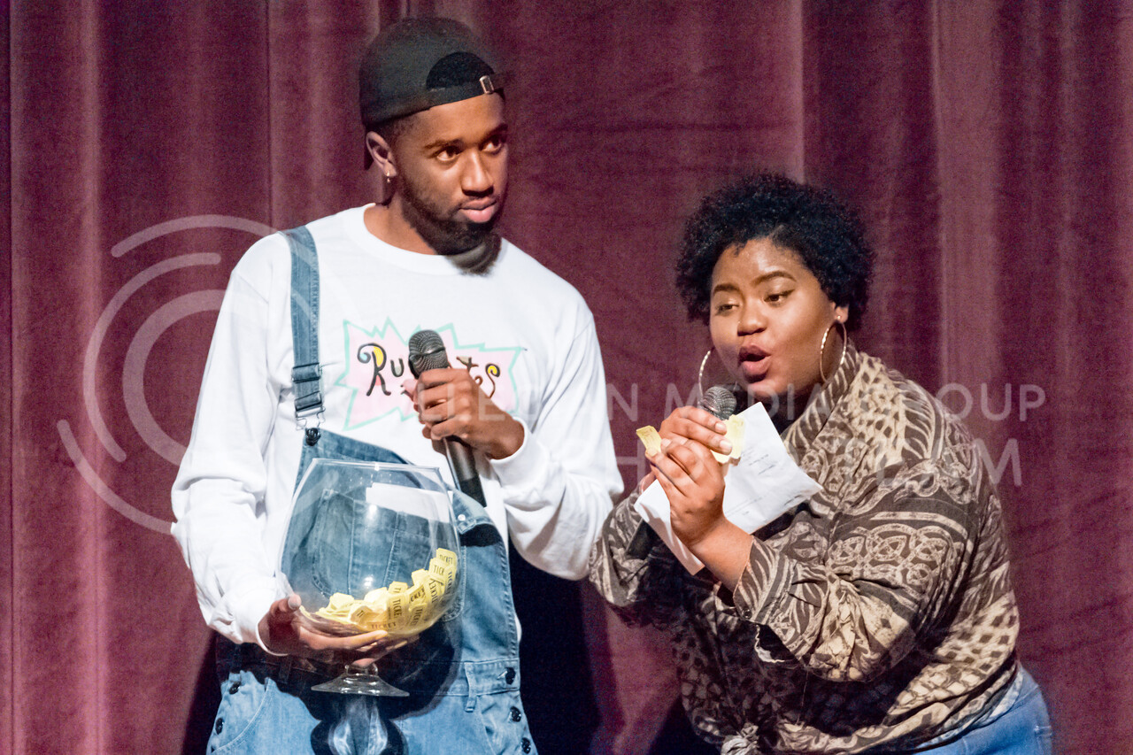 Shaneka Cabe and Tarrance Floyd read off ticktes for a raffle during an intermission of Poize's House party on 14 Nov, 2017 (Alex Shaw | Collegian Media Group)