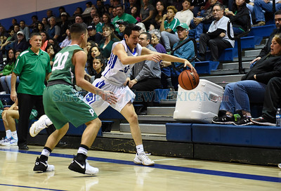 District 2-4A Tournament quarterfinal boy's basketball game between Pojoaque and St. Michael's played Wednesday, February 22, 2017 at Perez-Shelley Gymnasium, St. Michael's. Clyde Mueller/The New Mexican