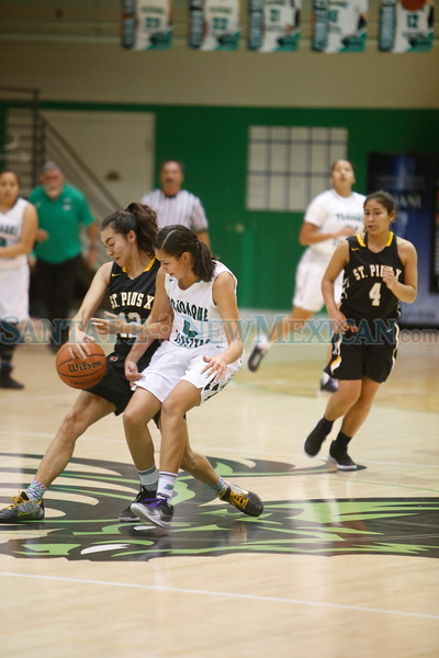 Pojoaque's Michaela Martinez, number 4, covers St. Pius' Maya Trujillo, number 12, during the first quarter of the Pojoaque Valley High School Vs St. Pius X High School at Pojoaque on Tuesday, January 7, 2019. Luis Sánchez Saturno/The New Mexican