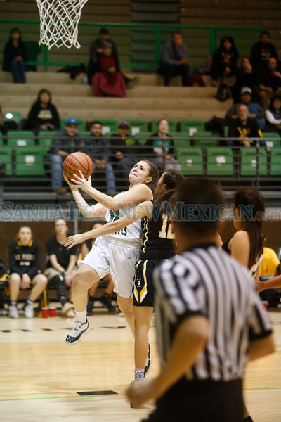 St. Pius' Maya Trujillo, number 12, covers Pojoaque's Adrianna Quintana, number 12, during the first quarter of the Pojoaque Valley High School Vs St. Pius X High School at Pojoaque on Tuesday, January 7, 2019. Luis Sánchez Saturno/The New Mexican