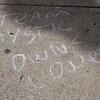 "A piece of ""graffiti"" — or, chalk on a sidewalk — outside Boarding House Park proclaims the in-game Team Mystic to be the favorite among Lowell's ""Pokemon Go"" players. Nashoba Valley Voice/Chris Lisinski"