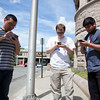"From left to right: Yasley Cartagena, 22, Steven Brunelle, 24, and Vannak Son, 24, walk around downtown Lowell on Monday while hunting for Pokemon in the ""Pokemon Go"" smartphone app. Nashoba Valley Voice/Chris Lisinski"