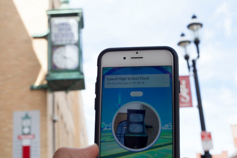 "Local art installations and landmarks, such as the Lowell High School clock (pictured), are coded into ""Pokemon Go"" as locations in the game where players can acquire items necessary for success. Nashoba Valley Voice/Chris Lisinski"