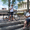 "Evan Tu (left), 13, and Luis Rosario, 31, play ""Pokemon Go"" on their phones near Lowell City Hall on Monday afternoon. Lowell Sun/Chris Tierney"
