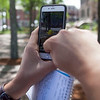 """Pokemon Go"" superimposes animated creatures onto the real world using a smartphone's camera, allowing players to catch and collect them in their neighborhoods. Lowell Sun/Chris Tierney"