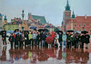 Our tour group fighting the rain in Warsaw (shot by a hired photographer). In the background at right is the Warsaw Castle, featured in this gallery.