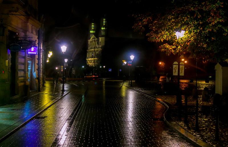Rainy street at night in old Krakow, Poland.