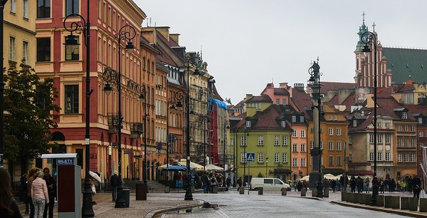 Old center section of downtown Warsaw, Poland. Not visible to the right is the Warsaw Palace, whose exterior was built for defense with a little ornamentation, straight walls, and small windows.