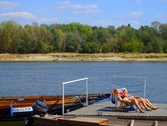 Tanning on the banks of the Vistula River in the summer