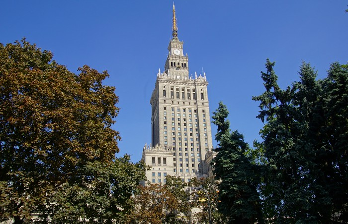 The Palace of Culture and Science framed by trees in Warsaw, Poland - Pałac Kultury i Nauki