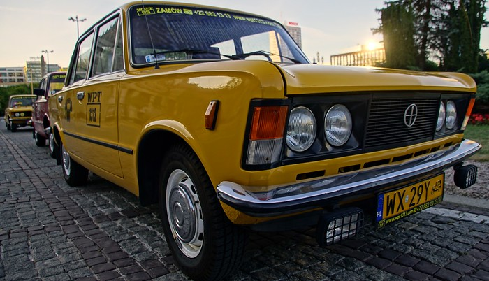 A yellow taxi in Warsaw, Poland