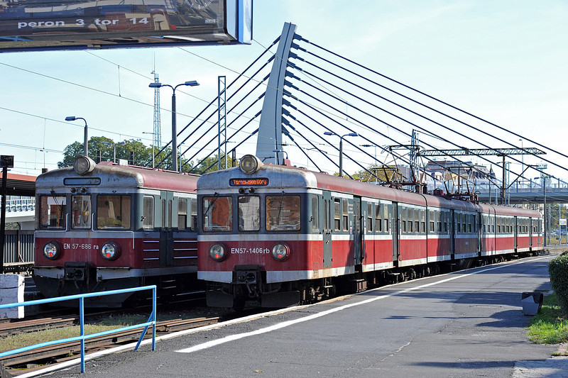 Opole is a regional centre for EMU services and the EN57 units are everywhere. With a fairly new road bridge as background PKP EN57-1406 and EN57-686 wait in the bay platforms