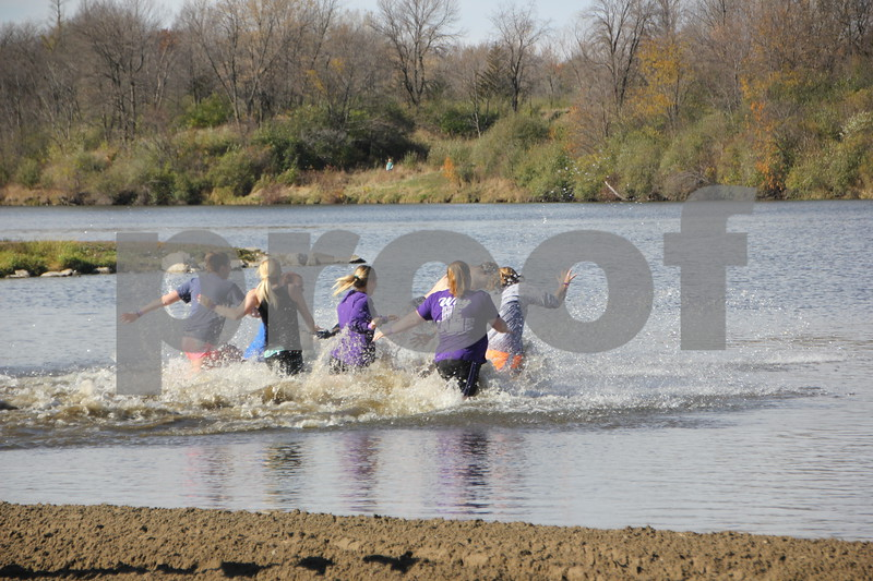 Members of the Iowa Central Community College's group, Student Ambassadors, is seen here taking the polar plunge. Sunday, November 1, 2015, Kennedy Park in Fort Dodge held the Polar Plunge fund raiser event for special Olympics.