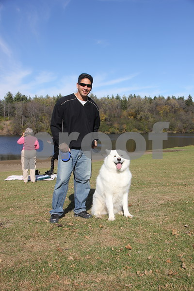Sunday, November 1, 2015, Kennedy Park in Fort Dodge held the Polar Plunge fund raiser event for special Olympics. Pictured (left to right)is: Matt Reynoso and his dog, Hunter. Matt's daughter was taking part in the  Polar Plunge.