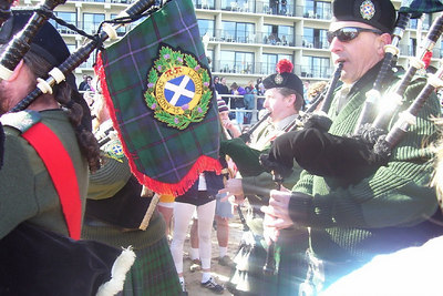 The bag pipes lead the procession to the beach....