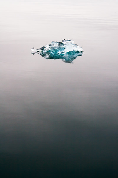 An ice cube hangs the ocean near Ny-Ålesund.