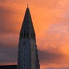 Hallgrímskirkja nestled between sunset and Reykjavik nightrise