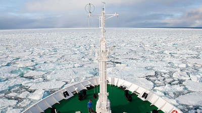 The Vavilov makes slow headway in heavy ice in the open ocean near the southern end of Spitsbergen.